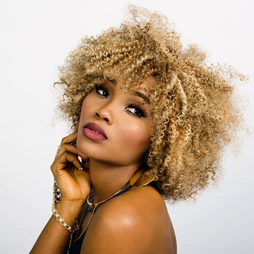 woman blonde curly hair